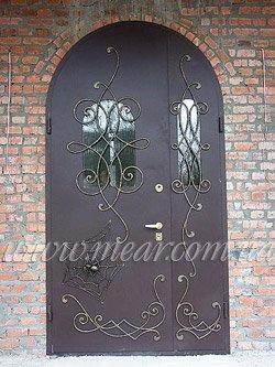 Двери с художественной ковкой